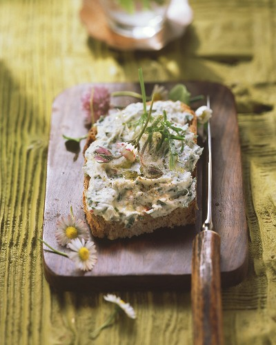Farmhouse bread with herb butter and daisies