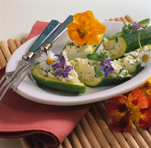 Courgettes stuffed with cream cheese, garnished with flowers