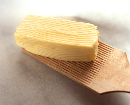 A Stick of Butter with Marks from Paddle