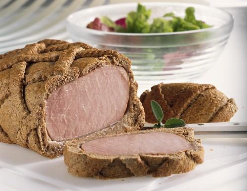 Smoked pork loin in bread casing