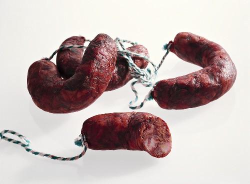 Red hard cured sausages from Spain (Chorizitos Ibericos de Jabugo)