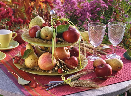 Late summer table decoration with apples, pears & cereal ears