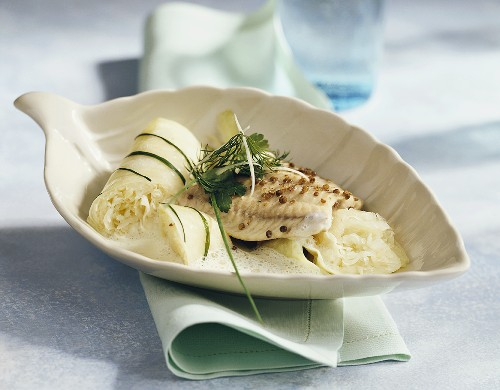 Steamed catfish fillet with sauerkraut roulades