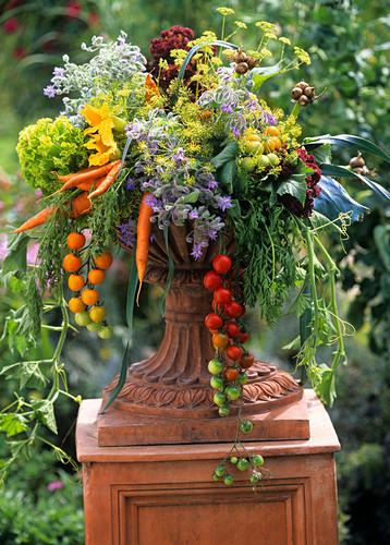 Colourful arrangement of vegetables in terracotta vase