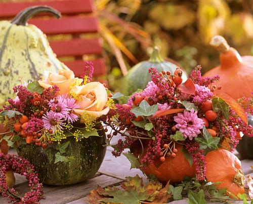 Two autumn flower arrangements in pumpkins