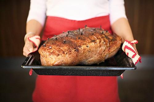 Roast ham studded with cloves