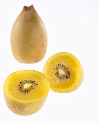 Golden kiwi fruit (Actinidia deliciosa Gold), whole and halved