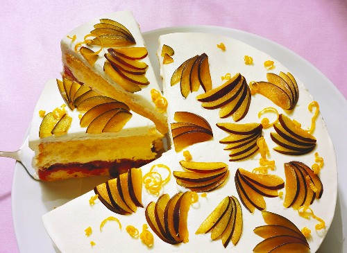 Plum gateau with cream and soft cheese filling