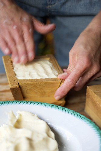 Shaping farmhouse butter in a wooden mould