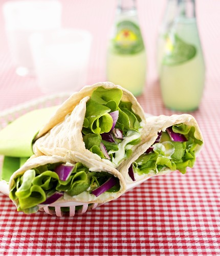 Wraps filled with avocado, red onions, lettuce & wasabi cream