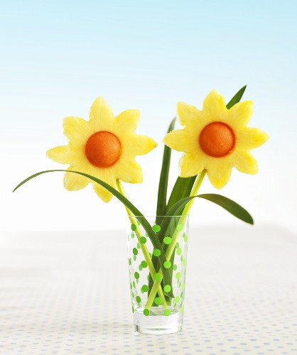 Pineapple and melon flowers in a glass