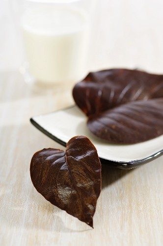 Chocolate leaves and glass of milk