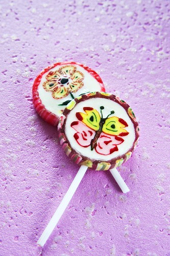 Lollipops, one with flower and one with butterfly