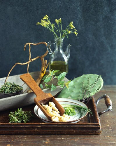 Still life with herbs, rapeseed oil and roots