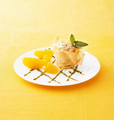 Plum brandy cream in pastry basket with sweet pesto