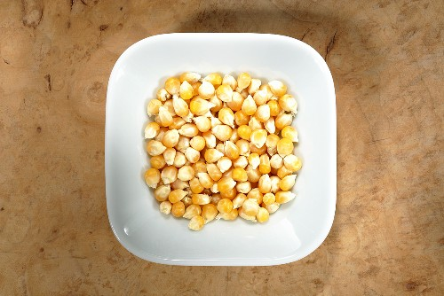 Corn kernels (popping corn) in dish from above