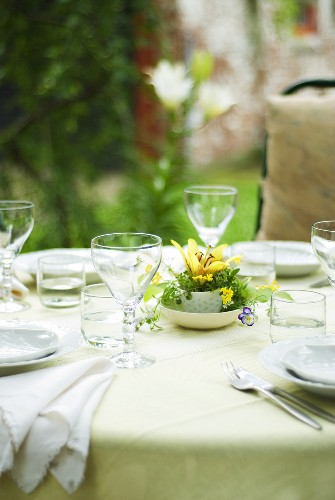 Laid table with spring flowers out of doors