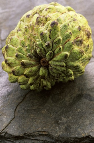 Cherimoya on stone slab