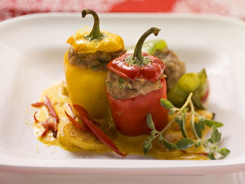 Stuffed mini peppers on pumpkin sauce