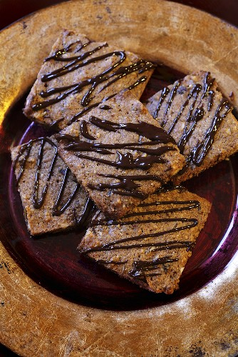 Nut biscuits with chocolate drizzle icing