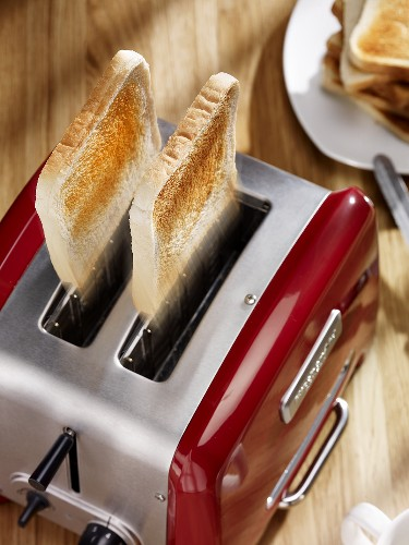 Slices of toast popping out of toaster