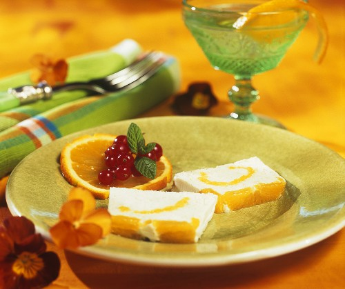 Two slices of orange parfait on dessert plate