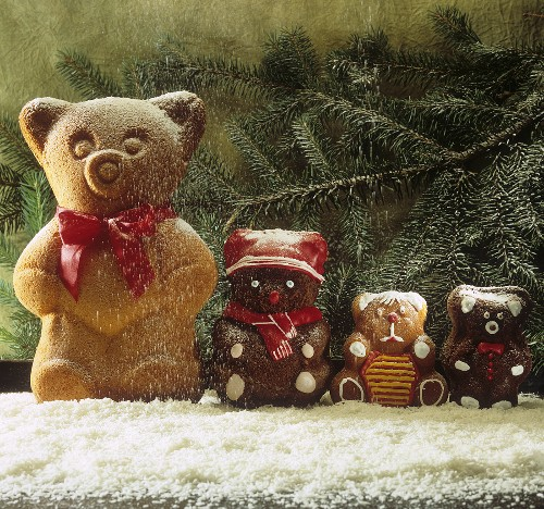 Baked chocolate cake bears in icing sugar snow