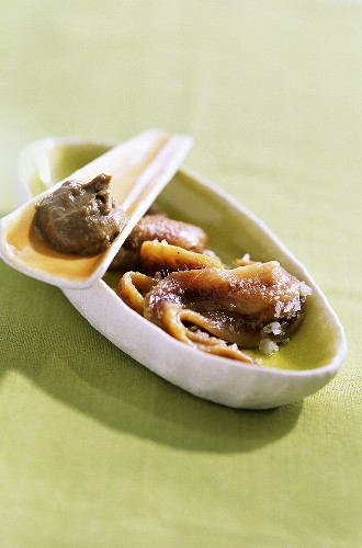 Anchovy paste and anchovies in a small bowl