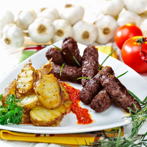 Cevapcici with grilled potato slices