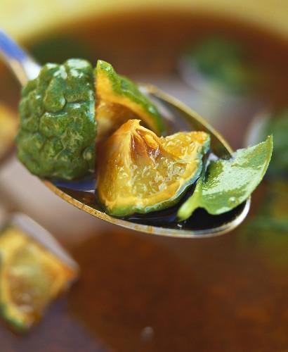 Soya and kaffir lime vinaigrette on a spoon