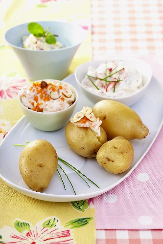 Potatoes cooked in their skins, with three dips