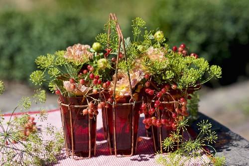 Glasses filled with viburnum berries, dahlias & dill