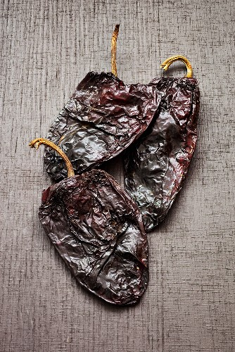 Three dried Poblano chili peppers