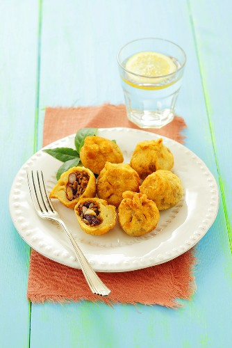 Deep-fried mini empanadas stuffed with minced meat and beans