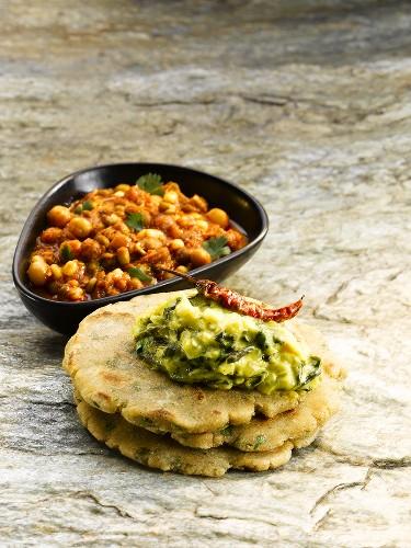 A dish from Maharashtra: mungo bean curry and bhakri (millet flatbread)