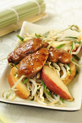 Quail breasts with sesame seeds on pears and soya sprouts