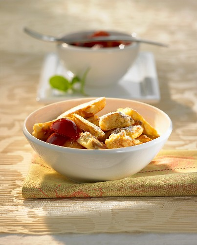 Kaiserschmarrn (shredded pancakes) with plum compote