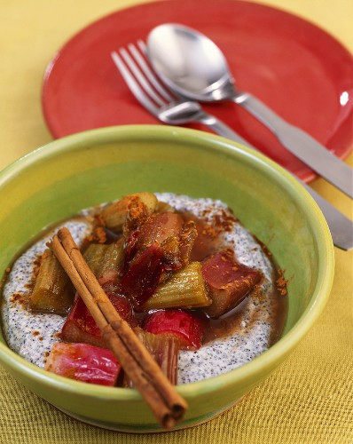 Rhubarb compote with cinnamon on poppy seed cream in a dish