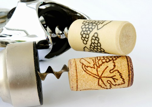 Real and plastic corks on corkscrews