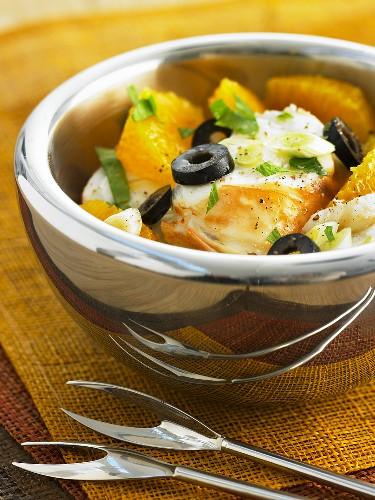 Spiny lobster salad with orange segments, olives & parsley