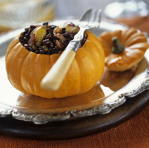 Pumpkin stuffed with lentils, bacon and sweet chestnuts