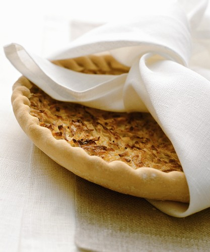 An onion tart wrapped in a fabric napkin