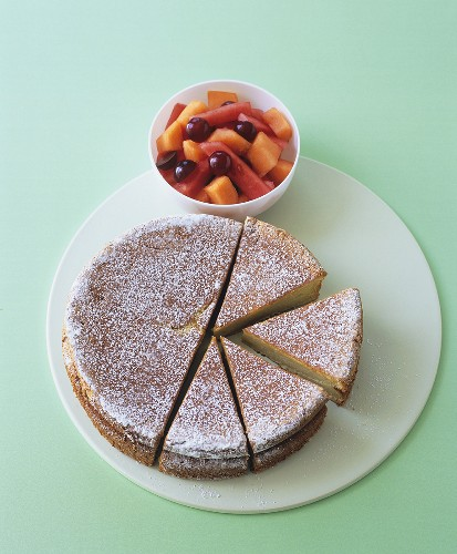 Olive oil and Sauternes cake with melon and grape salad