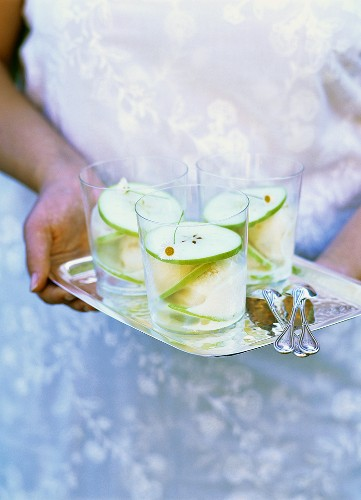 Apple sorbet with apple slices in glasses