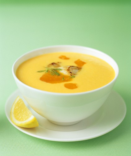 Cream of carrot soup with grilled scallop, carrot puree