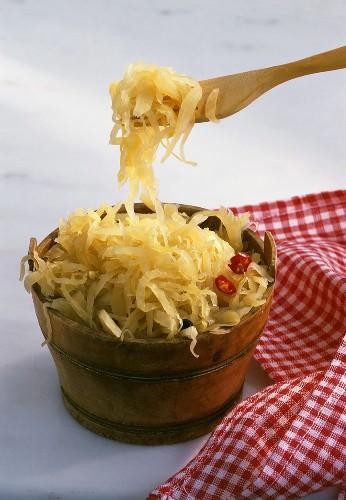 Tub of sauerkraut with wooden fork