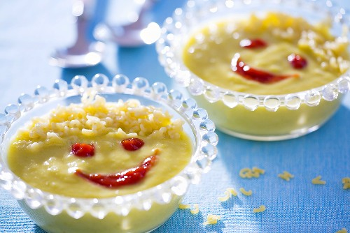 Vegetable cream soup with alphabet pasta, with faces