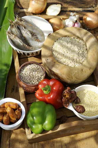 Ingredients for jambalaya on a wooden tray