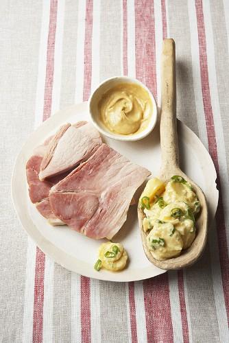 Pork shoulder with potato salad and mustard sauce
