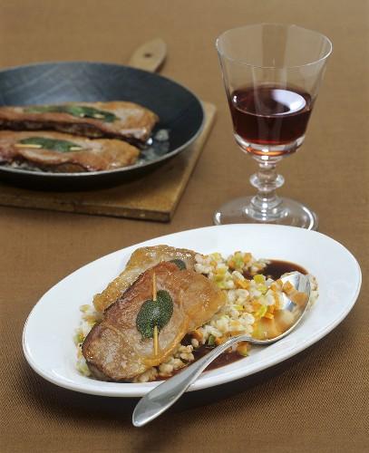 Lamb saltimbocca with Burgundy sauce on barley risotto